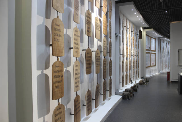 In this photo taken Thursday, Dec. 20, 2018, a wall of Quranic inscriptions hangs in a gallery dedicated to Abrahamic religions in Africa, seen in a Museum of Black Civilizations in Dakar, Senegal. The new museum in Dakar is the latest sign that welcoming spaces across the continent are being prepared. Focusing on Africa and its diaspora, it has been decades in the making. (AP Photo/Amelia Nierenberg)