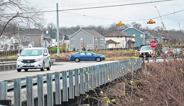 The Delaware County Engineer's Office will begin widening Home Road at the intersection of state Route 315 in February or March 2019. As seen in the photo, the two-lane bridge spanning the Olentangy River will be widened to accommodate additional lanes to match the improvements of the intersection.