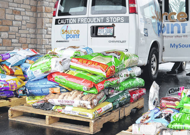 Pet food donations are unloaded at SourcePoint, where they are divided and distributed to Meals on Wheels clients for their pets.