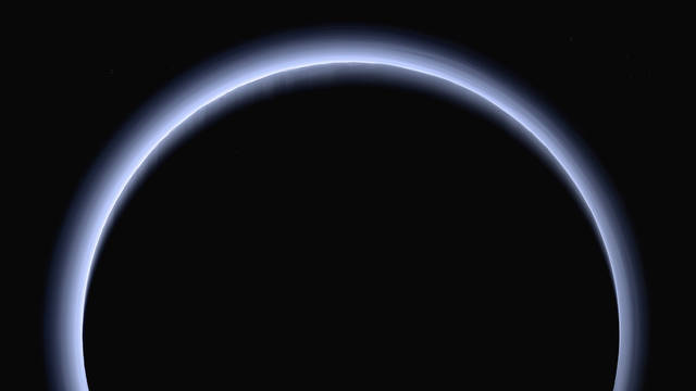 FILE - This image made available by NASA in March 2017 shows Pluto illuminated from behind by the sun as the New Horizons spacecraft travels away from it at a distance of about 120,000 miles (200,000 kilometers). The probe will ring in 2019 by exploring an even more distant and mysterious world. (NASA/Johns Hopkins University Applied Physics Laboratory/Southwest Research Institute via AP)