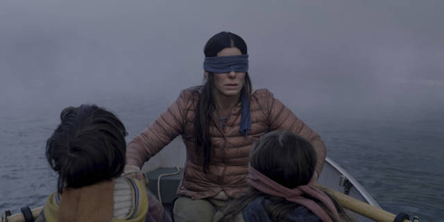 "FILE- This file image released by Netflix shows Sandra Bullock in a scene from the film, ""Bird Box."" Netflix lifted the usually tightly sealed lid on its viewership numbers in a recent tweet that disclosed 45 million subscriber accounts had watched the thriller, ""Bird Box,"" during its first seven days on the service. That made the film the biggest first-week success of any movie made so far for Netflix's 12-year-old streaming service. (Merrick Morton/Netflix via AP, File)"