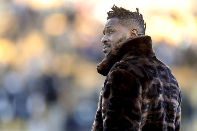 In this photo from Dec. 30, 2018, Pittsburgh Steelers wide receiver Antonio Brown stands on the sideline before an NFL football game against the Cincinnati Bengals, in Pittsburgh. Pittsburgh Steelers head coach Mike Tomlin says he's disappointed in the behavior of star wide receiver Antonio Brown but added the team has not received any formal trade request from Brown's camp. (AP Photo/Don Wright)