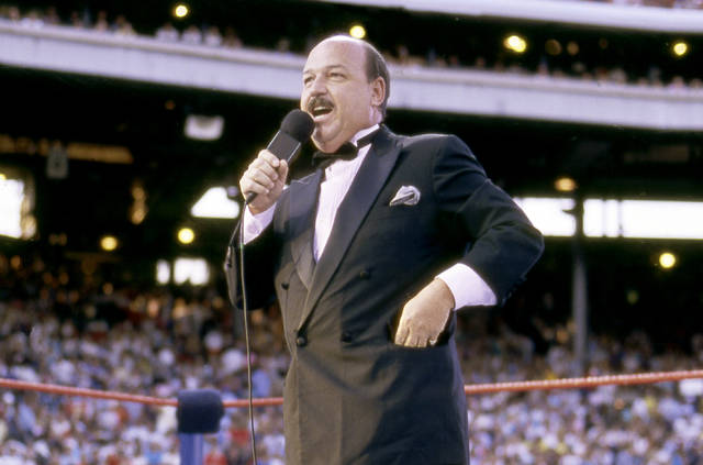 "In this July 31, 1988 photo provided by the WWE, ""Mean"" Gene Okerlund addresses the crowd before a pro wrestling event in Milwaukee.  Okerlund, who interviewed pro wrestling superstars ""Macho Man"" Randy Savage, The Ultimate Warrior and Hulk Hogan, has died. He was 76. WWE announced Okerlund's death on its website Wednesday, Jan. 2, 2019. (WWE via AP)"