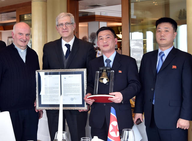 "This March 20, 2018 photo made available Thursday, Jan. 3, 2019 by the Parish of Farra di Soligo, shows North Korea's acting ambassador to Italy Jo Song Gil, second from right, holding a model of ""Bell of Peace of Rovereto"" during a cultural event on the occasion of a visit of the North Korean delegation to the Veneto region, in San Pietro di Feletto, near Treviso, northern Italy. Jo Song Gil, went into hiding with his wife in November, South Korea's spy agency told lawmakers in Seoul on Thursday. Jo Song Gil is flanked by Senator Valentino Perin, second from left, and don Brunone De Toffol, parish priest of Farra di Soligo, left, and an unidentified North Korean diplomat at right. (Parish of Farra di Soligo via AP)"