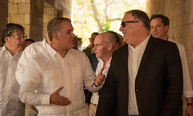 In this photo released by the Colombia's Presidency U.S. Secretary of State Mike Pompeo, right, and Colombia's President Ivan Duque talk during a meeting at the Presidential Guest House in Cartagena, Colombia, Wednesday, Jan. 2, 2019. (Nicolas Galeano/Colombia's Presidency via AP)