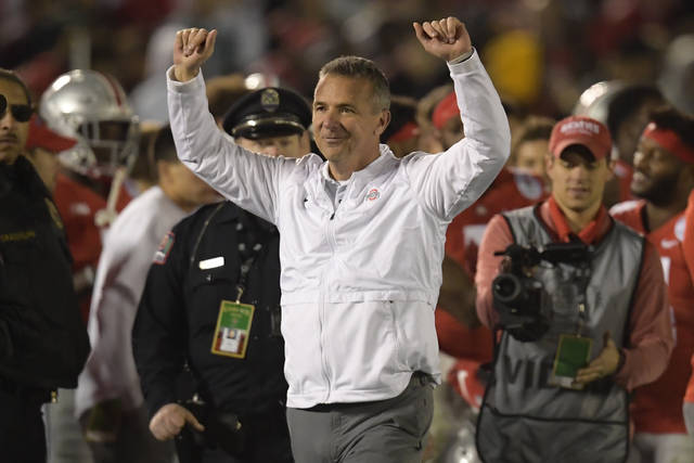 FILE - In this Tuesday, Jan. 1, 2019 file photo, Ohio State coach Urban Meyer celebrates at the end of the team's 28-23 win over Washington during the Rose Bowl NCAA college football game in Pasadena, Calif. Ohio State says the August investigation that led to a three-game suspension of football coach Urban Meyer cost the university $1 million, twice the amount originally requested for it. A school spokesman said Thursday, Jan. 3, 2019 that the initial $500,000 amount was preliminary and didn't reflect the whole anticipated cost. (AP Photo/Mark J. Terrill, File)