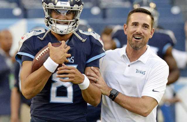 FILE - In this Aug. 30, 2018, file photo, Tennessee Titans quarterback Marcus Mariota (8) talks with offensive coordinator Matt LaFleur before a preseason NFL football game against the Minnesota Vikings in Nashville, Tenn. A person familiar with the decision says LaFleur has accepted Green Bay's offer to become the next head coach of the Packers. (AP Photo/Mark Zaleski, File)