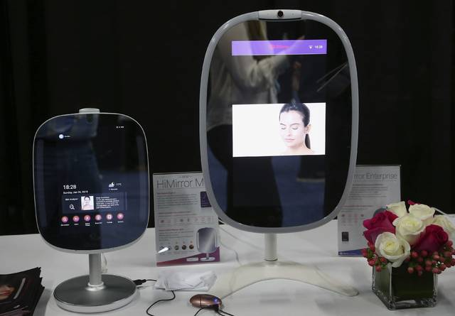 Two different sizes of the HiMirror uses its skin analysis technology, to assess your skin for wrinkles, fine lines, dark circles, dark spots, red spots, roughness, and pores, shown here at the CES Unveiled at CES International, Sunday, Jan. 6, 2019, in Las Vegas. (AP Photo/Ross D. Franklin)