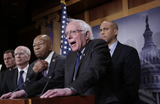 "Sen. Bernie Sanders, I-Vt., center, joined from left by Sen. Richard Blumenthal, D-Conn., Rep. Peter Welch, D-Vt., Rep. Elijah Cummings, D-Md., and Sen. Cory Booker, D-N.J., speaks to reporters as he prepares to introduce new legislation that aims to reduce what Americans pay for prescription drugs, especially brand-name drugs deemed ""excessively priced,"" during a news conference on Capitol Hill in Washington, Thursday, Jan. 10, 2019. (AP Photo/J. Scott Applewhite)"