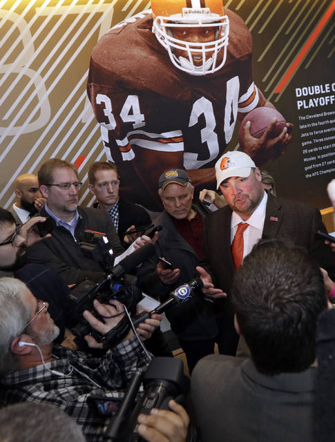 Cleveland Browns new NFL football head coach Freddie Kitchens, right, answers questions after a news conference, Monday, Jan. 14, 2019, in Cleveland. (AP Photo/Tony Dejak)