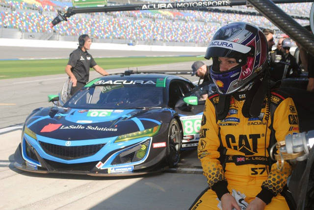 Katherine Legge of England waits to drive during a test session at Daytona International Speedway in Daytona Beach, Fla., Friday, Jan. 4, 2019. Legge is part of an all-female-driver team racing in the Rolex 24 at Daytona later this month. (AP Photo/Mark Long)