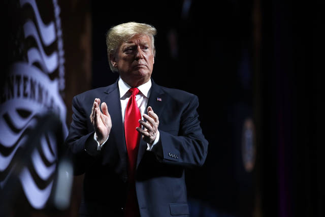 President Donald Trump acknowledges the crowd after speaking at the American Farm Bureau Federation convention in New Orleans, Monday, Jan. 14, 2019. (AP Photo/Jacquelyn Martin)