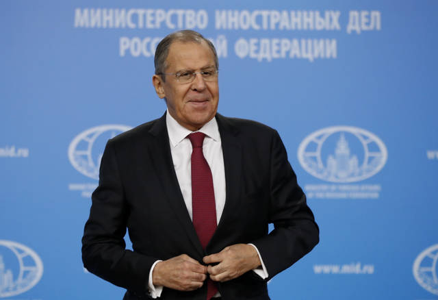 Russian Foreign Minister Sergey Lavrov prepares to leave his annual roundup news conference in Moscow, Russia, Wednesday, Jan. 16, 2019. Lavrov told a news conference that it's necessary to fully restore Syria's sovereignty, adding that Turkey's plan to create a buffer zone on the border with Syria should also be seen in that context. (AP Photo/Pavel Golovkin)