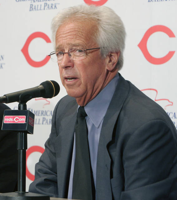 """FILE - In this April 2, 2007, file photo, Cincinnati Reds radio broadcaster Marty Brennaman answer questions at a news conference prior to a baseball game against the Chicago Cubs, in Cincinnati. Reds play-by-play broadcaster Marty Brennaman will retire after the 2019 season, his 46th in Cincinnati. The team made the announcement Wednesday, Jan. 16, 2019. The 76-year-old Brennaman joined the Reds' radio team in 1974 and soon became known for his sign-off line after each win: """"And this one belongs to the Reds."""" He and former Reds pitcher Joe Nuxhall shared the booth for 31 seasons from 1974-2004.(AP Photo/David Kohl, File)"""