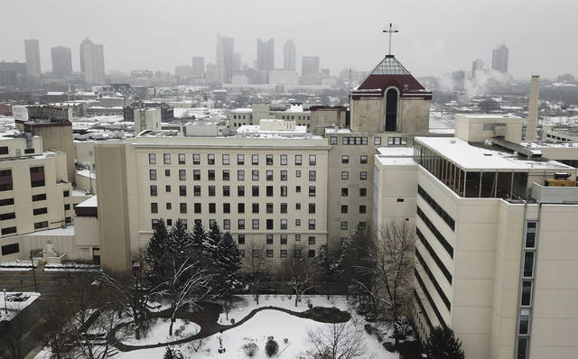 "This photo shows Mount Carmel Medical Center, a hospital in the Mount Carmel Health System, in Columbus, Ohio, Tuesday, Jan. 15, 2019. An intensive care doctor ordered ""significantly excessive and potentially fatal"" doses of pain medicine for at least 27 near-death patients in the past few years after families asked that lifesaving measures be stopped, the Ohio hospital system announced after being sued by a family alleging an improper dose of fentanyl actively hastened the death of one of those patients. (Doral Chenoweth III/The Columbus Dispatch via AP)"