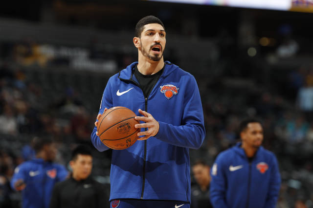 """FILE - In this Jan. 1, 2019, file photo, New York Knicks center Enes Kanter, of Turkey, warms up prior to the team's NBA basketball game against the Denver Nuggets, in Denver. Turkish media reports said Wednesday, Jan. 16, 2019, that Turkish prosecutors are seeking an international arrest warrant and had prepared an extradition request for Kanter, accusing him of membership in a terror organisation. Sabah newspaper said prosecutors were seeking an Interpol """"Red Notice"""" citing Kanter's ties to Fethullah Gulen, who Turkey blames for a failed 2016 coup, and accusing him of providing financial support to the group. (AP Photo/David Zalubowski, File)"""