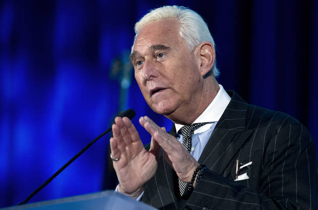FILE - In this Thursday, Dec. 6, 2018, file photo, Roger Stone speaks at the American Priority Conference in Washington. Stone, an associate of President Donald Trump, has been arrested in Florida. That's according to special counsel Robert Mueller's office, which says he faces charges including witness tampering, obstruction and false statements. Stone has been under scrutiny for months but has maintained his innocence. (AP Photo/Jose Luis Magana, File)