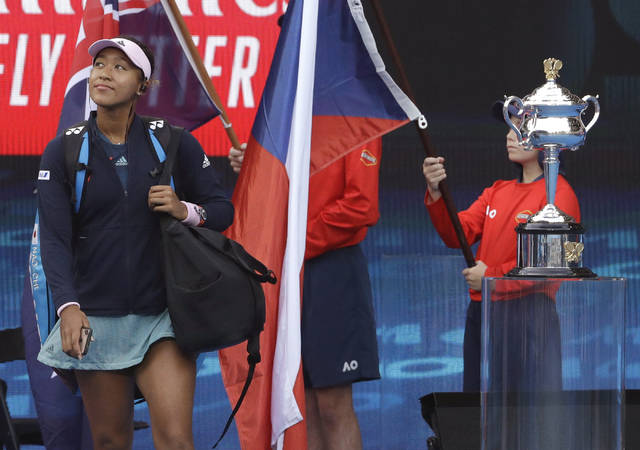 Japan's Naomi Osaka arrives at Rod Laver Arena for the women's singles final against Petra Kvitova of the Czech Republic at the Australian Open tennis championships in Melbourne, Australia, Saturday, Jan. 26, 2019. (AP Photo/Mark Schiefelbein)