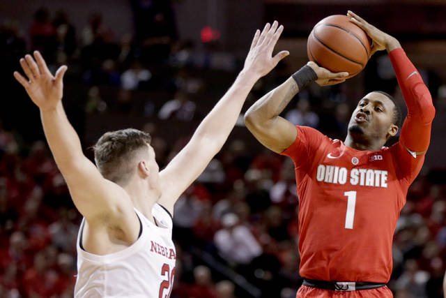Ohio State's Luther Muhammad (1) shoots over Nebraska's Tanner Borchardt (20) during the second half of an NCAA college basketball game in Lincoln, Neb., Saturday, Jan. 26, 2019. Ohio State won 70-60. (AP Photo/Nati Harnik)