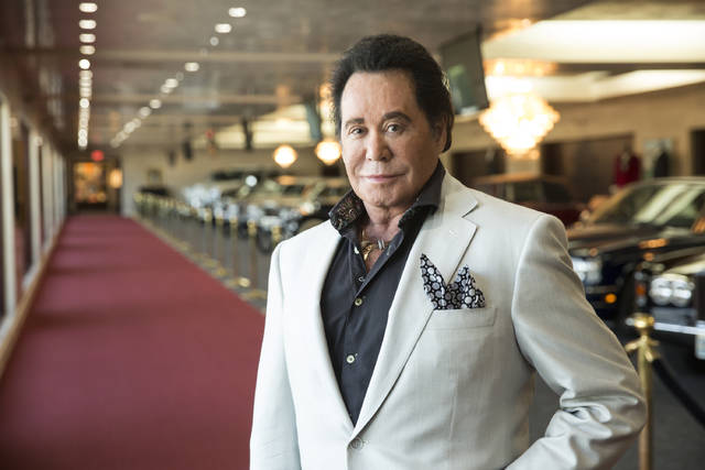 FILE- In this Sept. 8, 2015, photo, Wayne Newton poses for a photo at his home in Las Vegas. Newton will mark his 60th anniversary with a return to Caesars Palace casino-resort. His show starts Monday, Jan. 28, 2019, with dates scheduled through May. (Christopher DeVargas/Las Vegas Sun via AP, File)