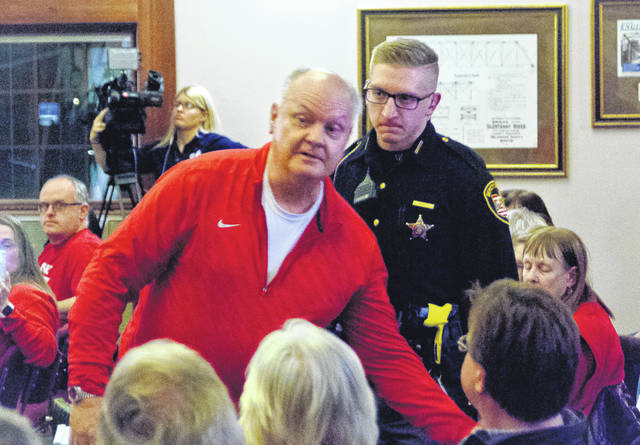 When a resident, pictured in red, questioned Liberty Township Trustee Melanie Leneghan on residents getting the chance to speak during Monday's meeting (Jan. 7), she asked a sheriff's deputy to remove him from the township hall.