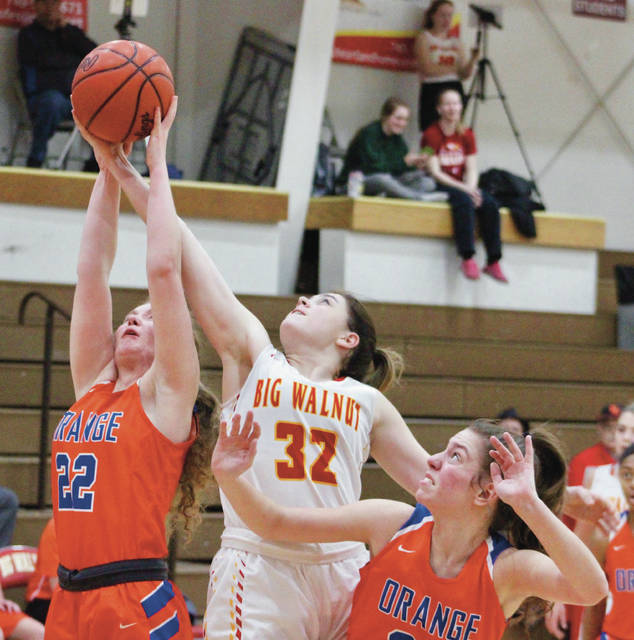 Big Walnut's Payton Carter (32) battles for a rebound with Olentangy Orange's Lauren Perone (22) and Riley Duffy during the first half of Tuesday's (Jan. 15) non-league showdown in Sunbury.