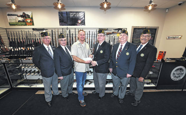 Post Vice Commander Glenn Daugherty accepting a check for $3,208 from one of the Gun Room owners, Jeff Fisher. Pictured L to R: Dick Doritty, Earl Redmond, Jeff Fisher, Glenn Daugherty, Gene Fuller, and Dick Morris.