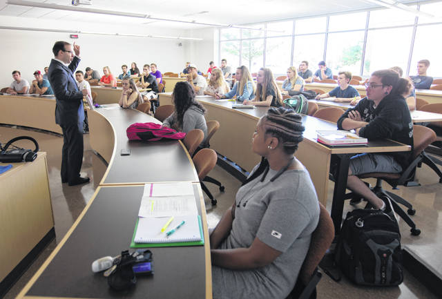 Associate economics professor Matthew Winden introduces materials to students on the first day of fall classes on Tuesday, September 4, 2018 in Hyland Hall on the UW-Whitewater campus.
