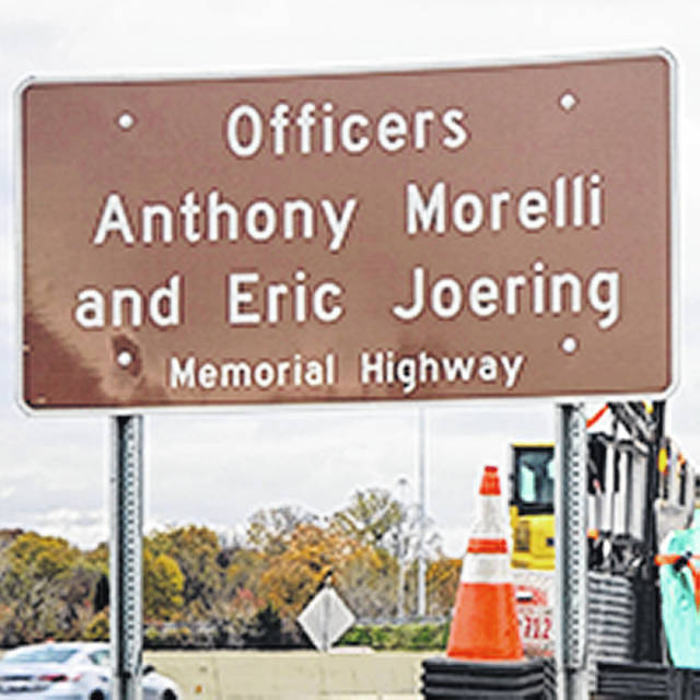 ODOT sign honoring Officers Morelli, Joering on I-270.