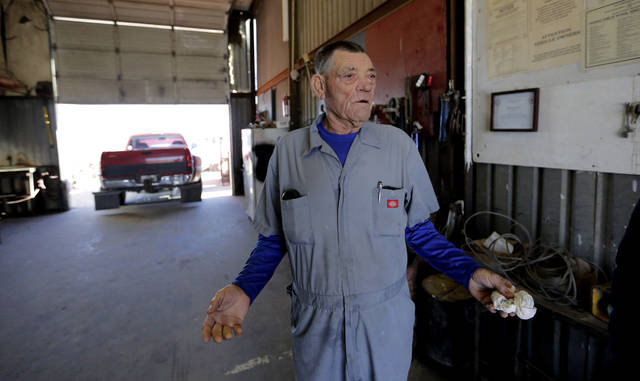 In this Wednesday, Jan. 23, 2019, photo, mechanic Terry Rose talks about the government shutdown at his business in Fort Hancock, Texas. A poll by The Associated Press-NORC Center for Public Affairs Research suggests staunch supporters of President Trump like Rose may be becoming harder to find, though. It showed that a majority of Americans blame the president for the shutdown and reject his argument that spending $5.7 billion on a border wall will significantly reduce crime, boost the U.S. economy or deter drug smugglers. (AP Photo/Eric Gay)