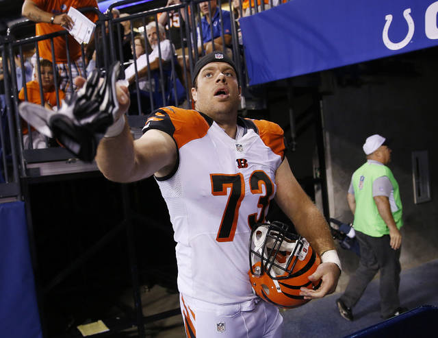 FILE - In this Sept. 3, 2015, file photo, Cincinnati Bengals' Eric Winston (73) throws his gloves to a fan following an NFL preseason football game against the Indianapolis Colts in Indianapolis. Avoiding a work stoppage in 2021 could depend on whether players can secure more guaranteed money in the next collective bargaining negotiations with the NFL. Winston says the best way to ensure more guaranteed money for players is to get them to free agency sooner. (AP Photo/AJ Mast, File)