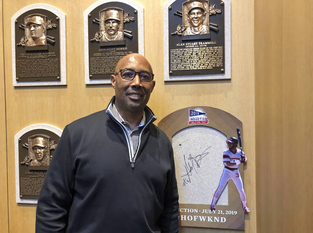 Hall of Fame inductee harold Baines poses where is plaques will hang as he visits the National Baseball Hall of Fame, Tuesday, Jan. 29, 2019, in Cooperstown, N.Y. Baines will inducted on July 21. (AP Photo/John Kekis)