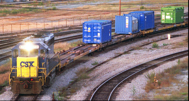 FILE - In this Sept. 29, 1994 file photo, a CSX Train with spent nuclear fuel passes through Florence, S.C., on its way to Savannah River Site Weapons Complex near Aiken S.C. Nevada and South Carolina are jostling for a home-field advantage of sorts in a federal court battle that could result in a metric ton of weapons-grade plutonium being stored 70 miles from Las Vegas.  (Jeff Chatlosh/The Morning News via AP, File)