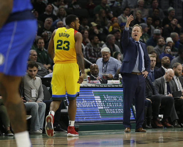 Milwaukee Bucks head coach Mike Budenholzer, right, yells from the sideline during the second half of an NBA basketball game against the Dallas Mavericks, Monday, Jan. 21, 2019, in Milwaukee. (AP Photo/Aaron Gash)