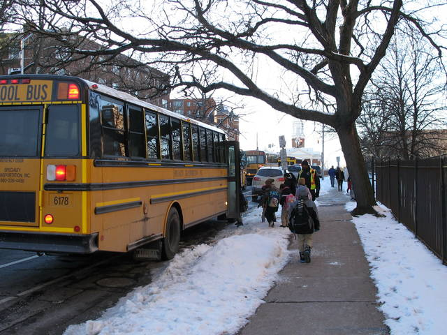 "Students board a bus after being dismissed from the Dr. Ramon Betances Elementary School in Hartford, Conn., on Thursday, Jan. 31, 2019. The extreme weather that shuttered schools across a swath of the northern United States this week has spurred debates on whether such closings are appropriate and whether school districts today might be getting ""soft,"" as suggested by Kentucky's governor. (AP Photo/Dave Collins)"