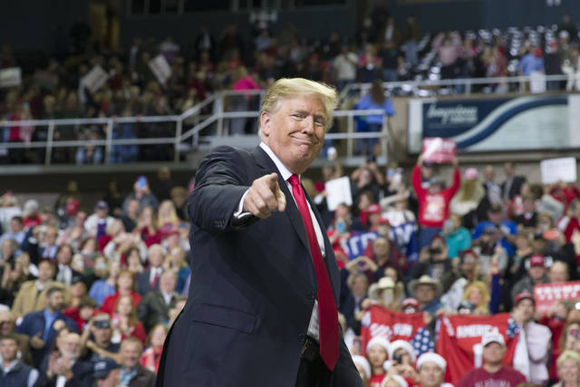 FILE - In this Nov. 26, 2018, file photo, President Donald Trump points to a supporter as he departs a rally at the Mississippi Coast Coliseum in Biloxi, Miss. President Donald Trump's campaign has launched a state-by-state effort to prevent an intraparty fight that could spill over into the general-election campaign. The initiative includes changing state party rules, crowding out potential rivals and quelling any early signs of opposition. (AP Photo/Alex Brandon, File)