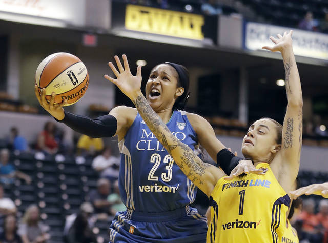 FILE - In this Aug. 30, 2017, file photo, Minnesota Lynx's Maya Moore, left, shoots against Indiana Fever's Jazmon Gwathmey during the first half of a WNBA basketball game in Indianapolis. Minnesota Lynx star Maya Moore has decided to skip the upcoming WNBA season. Moore announced Tuesday, Feb. 5, 2019 on The Players' Tribune website that she'll sit out in 2019. She already took the fall and winter off from international competition. The five-time first-team All-WNBA honoree has helped the Lynx win four championships since her rookie year, 2011. (AP Photo/Darron Cummings, File)