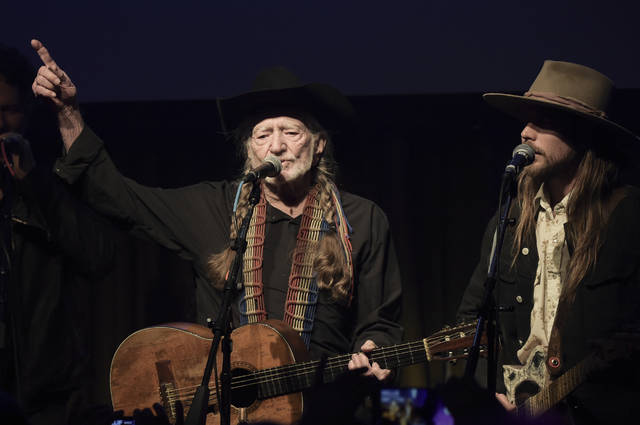 Willie Nelson, left, and Lukas Nelson perform at the Producers & Engineers Wing 12th Annual GRAMMY Week Celebration at the Village Studio on Wednesday, Feb. 6, 2019, in Los Angeles. (Photo by Richard Shotwell/Invision/AP)