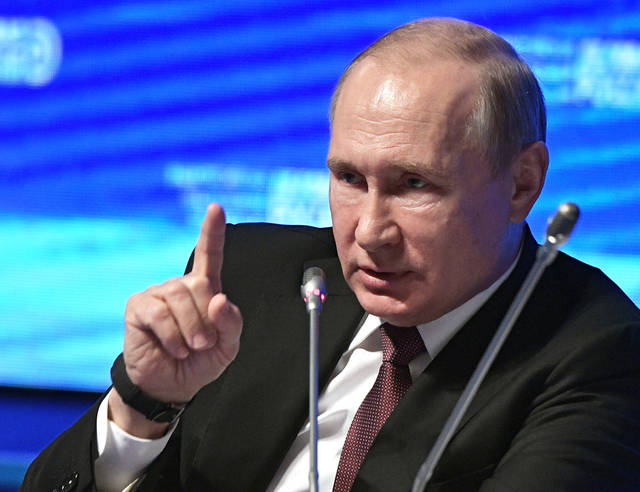 Russian President Vladimir Putin makes a point as he speaks at the plenary session of the Business Russia forum in Moscow, Russia, Wednesday, Feb. 6, 2019. (Alexei Nikolsky, Sputnik, Kremlin Pool Photo via AP)