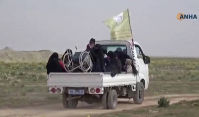 "In this Sunday, Feb. 10, 2019 image from video provided by Hawar News Agency, ANHA, an online Kurdish news service, civilians flee fighting near Baghouz, Syria. Fierce fighting was underway Monday between U.S.-backed Syrian forces and the Islamic State group around the extremists' last foothold in eastern Syria. The capture of the IS-held village of Baghouz and nearby areas would mark the end of a four-year global war to end IS' territorial hold over large parts of Syria and Iraq, where the group established its self-proclaimed ""caliphate"" in 2014. (ANHA via AP)"