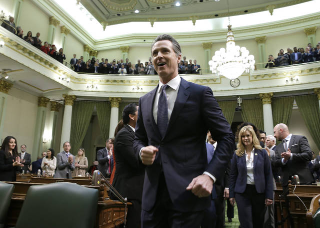 California Gov. Gavin Newsom walks up up the center aisle of the Assembly Chambers to deliver his first of the State of the State address to a joint session of the legislature at the Capitol Tuesday, Feb. 12, 2019, in Sacramento, Calif. (AP Photo/Rich Pedroncelli)