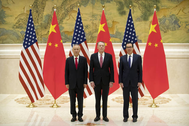From left, Chinese Vice Premier and lead trade negotiator Liu He, U.S. Trade Representative Robert Lighthizer, and U.S. Treasury Secretary Steven Mnuchin pose for a photo before the opening session of trade negotiations at the Diaoyutai State Guesthouse in Beijing, Thursday, Feb. 14, 2019. (AP Photo/Mark Schiefelbein, Pool)