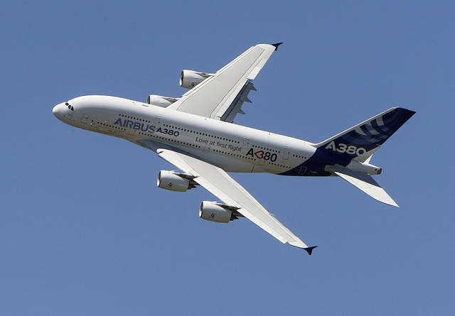 FILE - In this June 26, 2011, file photo, an Airbus A380 performs during a demonstration flight at the 49th Paris Air Show at Le Bourget airport, east of Paris. Airbus said Thursday, Feb. 14, 2019 it will stop making A380 superjumbo jets in 2021 after struggling to win clients. (AP Photo/Francois Mori, File)