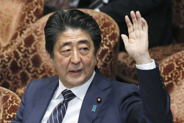 "Japanese Prime Minister Shinzo Abe raises his hand during a parliamentary session at the Lower House in Tokyo, Monday, Feb. 18, 2019. Abe and his chief spokesman have declined to say if Abe nominated President Donald Trump for a Nobel Peace prize. Speaking in parliament on Monday, Abe said the Nobel committee has never in a half-century disclosed the identity of the person or groups behind such nominations. He said, ""I thus decline comment.""(Kyodo News via AP)"