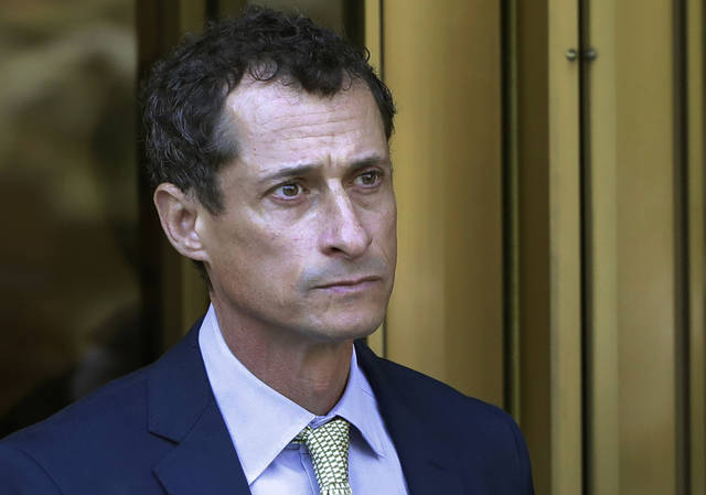 FILE - In this Sept. 25, 2017 file photo, former Congressman Anthony Weiner leaves federal court following his sentencing in New York. Weiner has been released from federal prison in Massachusetts. The New York Democrat, a once-rising star who also ran for mayor, was convicted of having illicit online contact with a 15-year-old North Carolina girl in 2017. The Federal Bureau of Prisons website now shows Weiner is in the custody of its Residential Re-entry Management office in Brooklyn, New York. It's not immediately clear when he was transferred and where he's currently staying. The bureau, federal court in New York and Weiner's lawyer didn't immediately comment. (AP Photo/Mark Lennihan, File)
