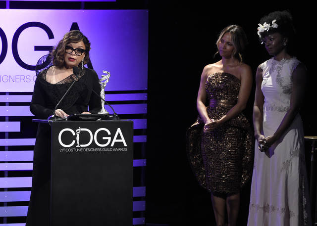 Ruth E. Carter accepts the career achievement award as Danai Gurira, from right, and Halle Berry look on at the 21st annual Costume Designers Guild Awards at The Beverly Hilton Hotel on Tuesday, Feb. 19, 2019, in Beverly Hills, Calif. (Photo by Chris Pizzello/Invision/AP)