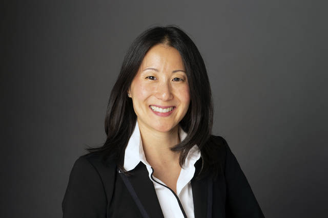 This 2019 photo provided by USA Gymnastics shows Li Li Leung. USA Gymnastics is turning to NBA executive Li Li Leung to help turn the embattled program around. The organization named Leung as its new president and chief executive officer on Tuesday, Feb. 19, 2019,  as it fights to retain its status as the national governing body for the sport after the Larry Nassar sexual abuse scandal. Leung served as vice president of global partnerships for the NBA. She arrives as USA Gymnastics attempts to fend off decertification from the United States Olympic Committee. (Wendy Barrows Photography/USA Gymnastics via AP)