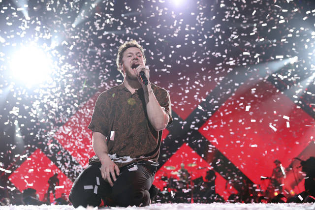 FILE- In this Feb. 1, 2018, file photo Imagine Dragons perform at the EA Sports Bowl at The Armory in Minneapolis. Imagine Dragons will perform at the Pro Football Hall of Fame to help kick off the NFL's 100th season. The Hall announced Tuesday, Feb. 19, 2019, that the alternative-rock band will headline the Concert for Legends on Aug. 4. (Photo by Omar Vega/Invision/AP, File)