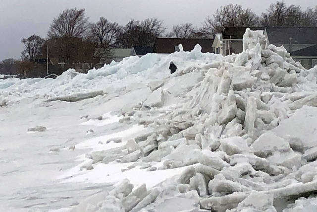 Mounds of ice collect along the Lake Erie shore at Hoover Beach, in Hamburg, NY, Monday, Feb. 25, 2019. High winds howled through much of the nation's eastern half for a second day Monday, cutting power to hundreds of thousands of homes and businesses, closing schools, and pushing dramatic mountains of ice onto the shores of Lake Erie. (AP Photo/Carolyn Thompson)