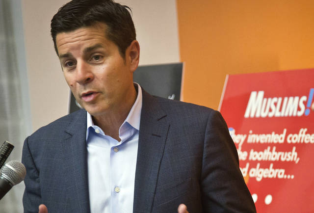 FILE - In this June 25, 2015, file photo, Muslim comedian Dean Obeidallah speaks at a news conference in New York. The radio host is asking a federal court in Ohio to award him more than $1 million in damages for his claims that a neo-Nazi website operator falsely accused him of terrorism. Attorneys for Obeidallah said in a court filing Friday, Feb. 22, 2019, that they are seeking $250,000 in compensatory damages and $1 million in punitive damages from The Daily Stormer founder Andrew Anglin and his company. Anglin hasn't formally responded to the suit.  (AP Photo/Bebeto Matthews, File)